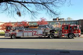 a city of albany fire engine is parked across the street from the south end fire