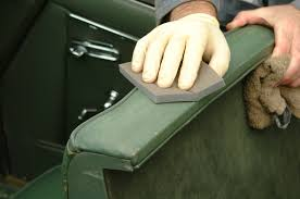 sand rough leather surfaces carefully