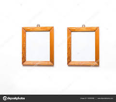 2 old wooden frames of pine wood hanging on white wall background wooden frame on white wall photo by milosz