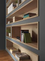 Built-In Bookshelves Lined With Wood Highlight The Displayed Decor