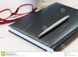 office agenda agenda pen and glasses on a wooden table stock image image of