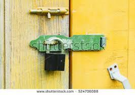 old lock on the door lock on the door of an old farmhouse true