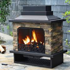 stand alone outdoor fireplace with steel door frame also wood burning material and exposed stone design