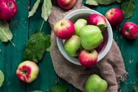 green and red apples. green and red apples in a bowl, on wooden table. t