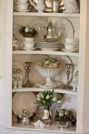 Spring Cupboard - such a pretty display of dishes, silver and Spring decor -