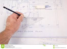 Architect  Drawing Up Plans For A House Royalty Free Stock Image    Architect  drawing up plans for a house
