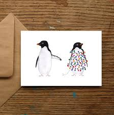 festive penguins christmas cards by nic allan | notonthehighstreet.com