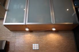 Lighting: Under Cabinet Puck Lights With Kitchen Tile Wall And ...