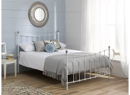 Finished in a classic, crisp white, our Jasmine metal bed frame is a  delicate