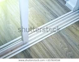 sliding glass door rail modern white sliding glass door with rail on wooden floor sliding glass sliding glass door rail
