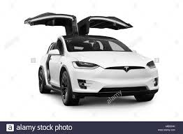 white tesla model x luxury suv electric car with open falcon wing doors 2018 isolated on white background