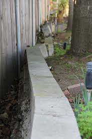 tree roots pushing against a retaining wall is one of the most common problems with unreinforced