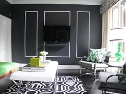 geometric printed rug with elegant black accent wall for superb art deco living room ideas with white ottoman coffee table on art deco wall decor ideas with geometric printed rug with elegant black accent wall for superb art