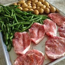 baked thin pork chops and veggies sheet
