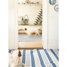 striped dash and albert rugs on cozy wood flooring and l and stick wallpaper