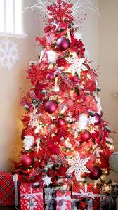 Red and white snowflake Christmas tree lit