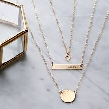 a horizontal 14k gold filled bar diamond initial tag and hammered disc necklace set