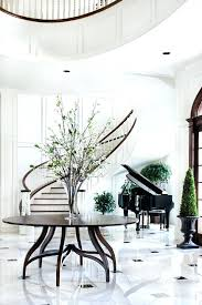 round table foyer traditional round entryway table flowery vase grand piano stairs cool flooring wide space