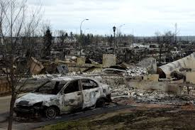 Alberta premier tours fire-ravaged Fort McMurray