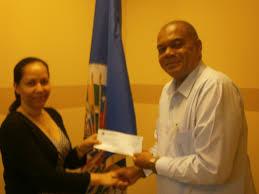 oas the representative presented check to mr michael tucker executive director of national council