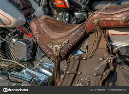 a typical biker leather bag motorbike accessories vintage effect filter photo by lorenza62
