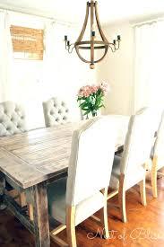 striking round chandelier over rectangular table large