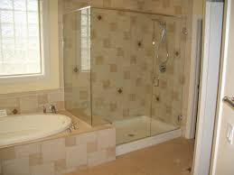 bathroom shower ideas with transpa glass door and cream wall tile also large white framed window also white bathtub