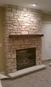 extraordinary stacked stones wall panels with wooden floating mantel as inspiring traditional fireplace hearth ideas