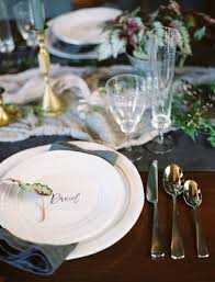 Moody indoor wedding editorial with stunning lush florals by The Southern  Table in rich purples.