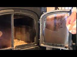how to clean fireplace glass removing burnt on soot from glass