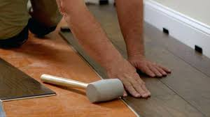 installing vinyl flooring over painted concrete cost to install in bathroom
