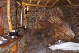 Aquila Private Game Reserve: My cave bathroom with hot and cold running  water.