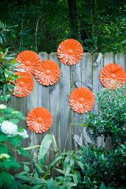 brilliant orange fl decorations on the fence