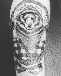 фото татуировки медведь в стиле лайнворк татуировки на руке