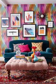 how to hang artwork in a gallery wall style inside the colourful home of interior