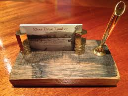 custom business card holder with pen funnel mounted on a piece of a whiskey barrel stave