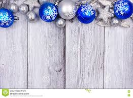 Blue And Silver Christmas Ornament Top Border On White Wood Stock ...