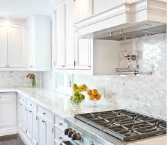 white kitchen cabinets with oblong marble tiles