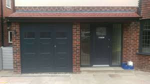 anthracite powder coated off center split side hinged garage door plete with windows installed by avemoor