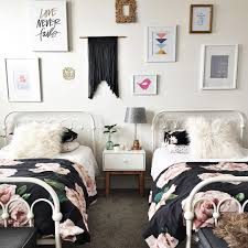 mesmerizing shared girl bedroom with vintage sheets and metal twin beds