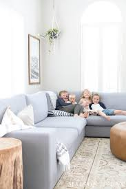 this huge gray sectional is perfect for a family room find out how to decorate