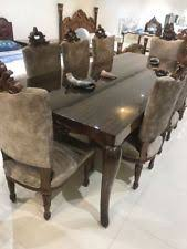 dining table and 8 chairs set in indian m p teak wood brown fabric seats