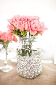 Silver glitter dipped mason jar with pink flowers. Perfect for a wedding  shower centerpiece.