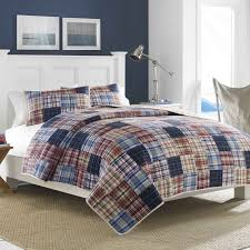 This beautiful quilt is designed after a patchwork style, in hues ... & This beautiful quilt is designed after a patchwork style, in hues of blue  and khaki Adamdwight.com