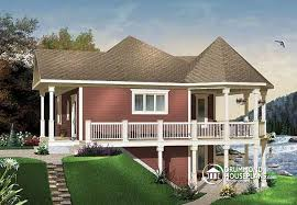 House plan W A detail from DrummondHousePlans comfront   BASE MODEL Wraparound porch lakefront cottage house plan  master bedroom on main floor