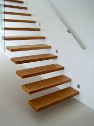 A modern stair incorporating engineered cantilevering treads