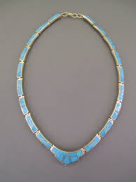 gold turquoise inlay neclace by native american jewelry artist tim charlie navajo