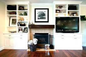 built in bookshelves around fireplace bookcases next to