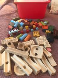 selection of wooden toys marble run blocks houses train