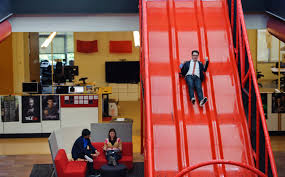 the google office. Chris Dale, Manager Of Global Communications For Google And YouTube, Goes Down A Slide The Office